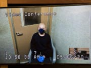 Brent Luyster III makes a first appearance via video in May in Clark County Superior Court on suspicion of attempted second-degree murder. He is accused of trying to attack a man with a knife in Vancouver's Rose Village neighborhood.
