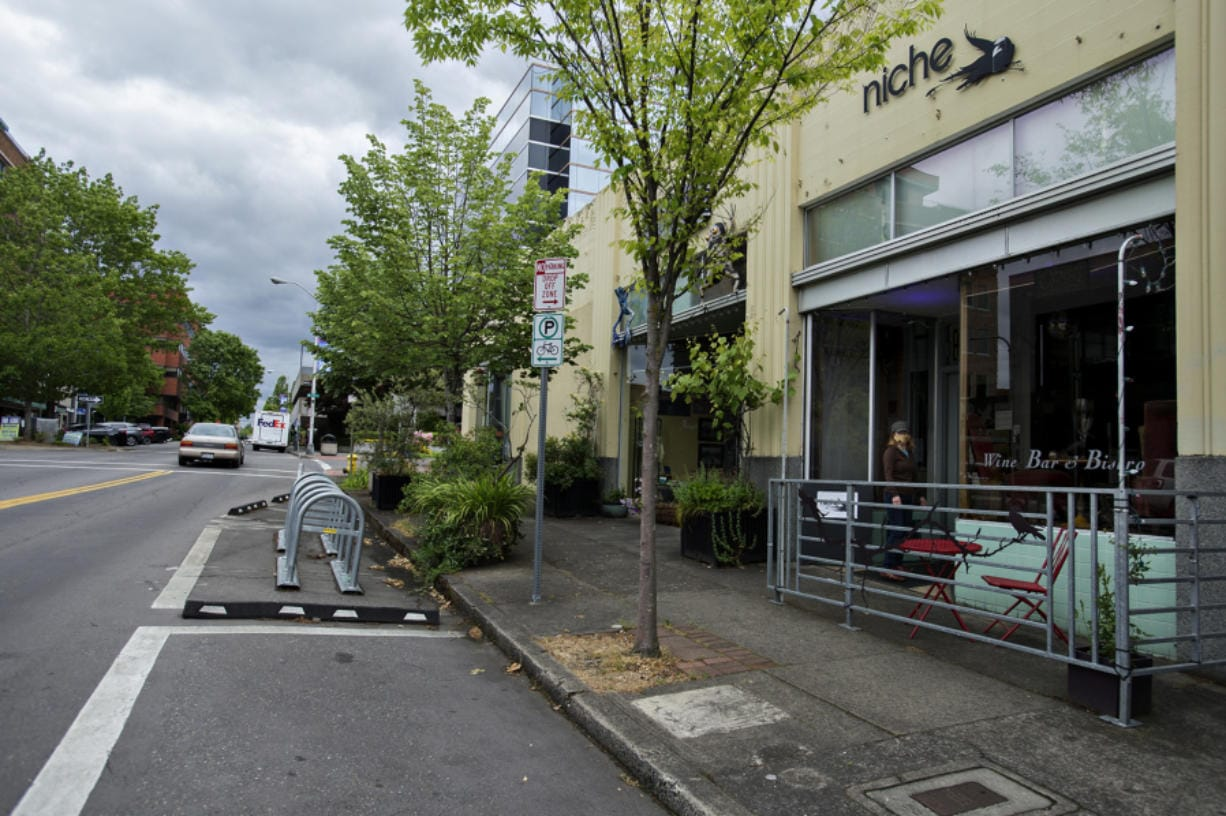 The city may allow outdoor seating in parking/loading zones, foreground center, in front of businesses such as Niche Wine Bar in downtown Vancouver.