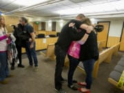 Members of Hartley Anderson's family embrace in the courtroom after the sentencing of Ryan Burge, who was convicted of murdering the 5-year-old girl, in Clark County Superior Court on Friday afternoon. Burge was sentenced to 40 years in prison. Family members are Hartley's grandmother Carla Luchau, father Peter Anderson, grandfather Tim Luchau, uncle T.J. Luchau, mother Nataasha Tafoya and aunt Whitney Nailon.