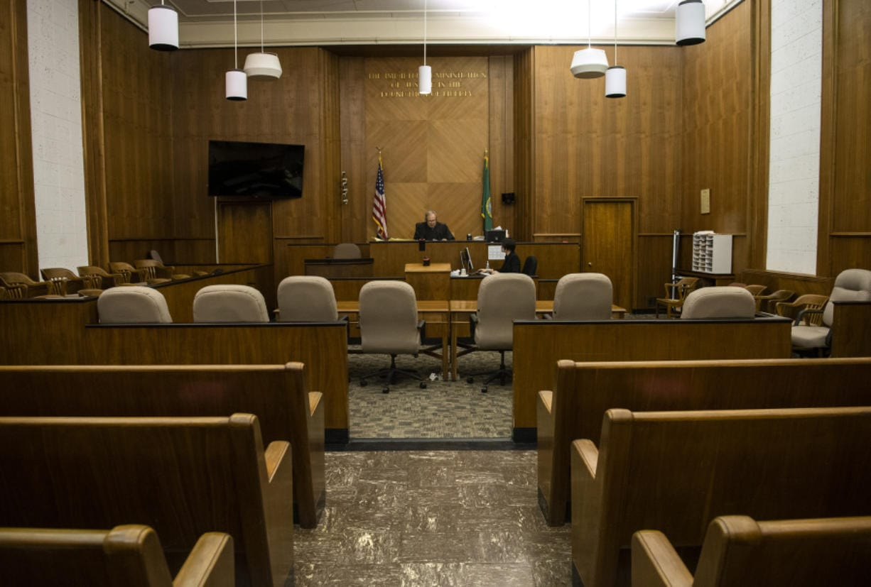 Court is in session - remotely. Clark County Superior Court Judge Scott Collier runs through the Adult Drug Court docket over the phone in an empty courtroom on Thursday. Many of the drug court programs are currently being conducted over the phone or over video due to the coronavirus pandemic.