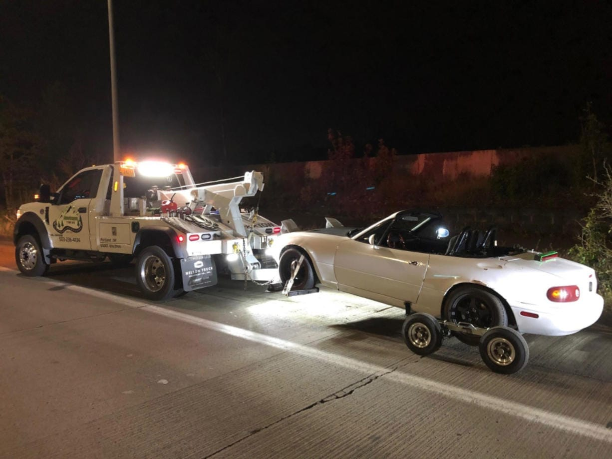 A white Mazda Miata allegedly used in street racing is impounded by Portland Police on April 19. A man from Ridgefield was one of four suspects arrested in connection with the incident.