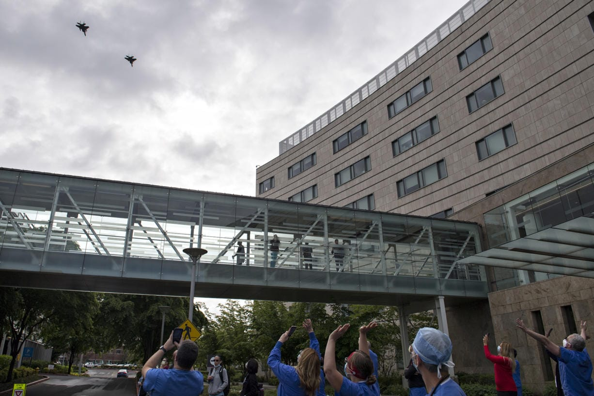 Pilots from the Oregon Air National Guard honor health care workers, first responders, and other essential staff who are working to keep local residents safe with a flyover at Legacy Salmon Creek Medical Center on Friday morning. The tribute, which traveled west to east over the facility, continued on to visit other hospitals in the region.