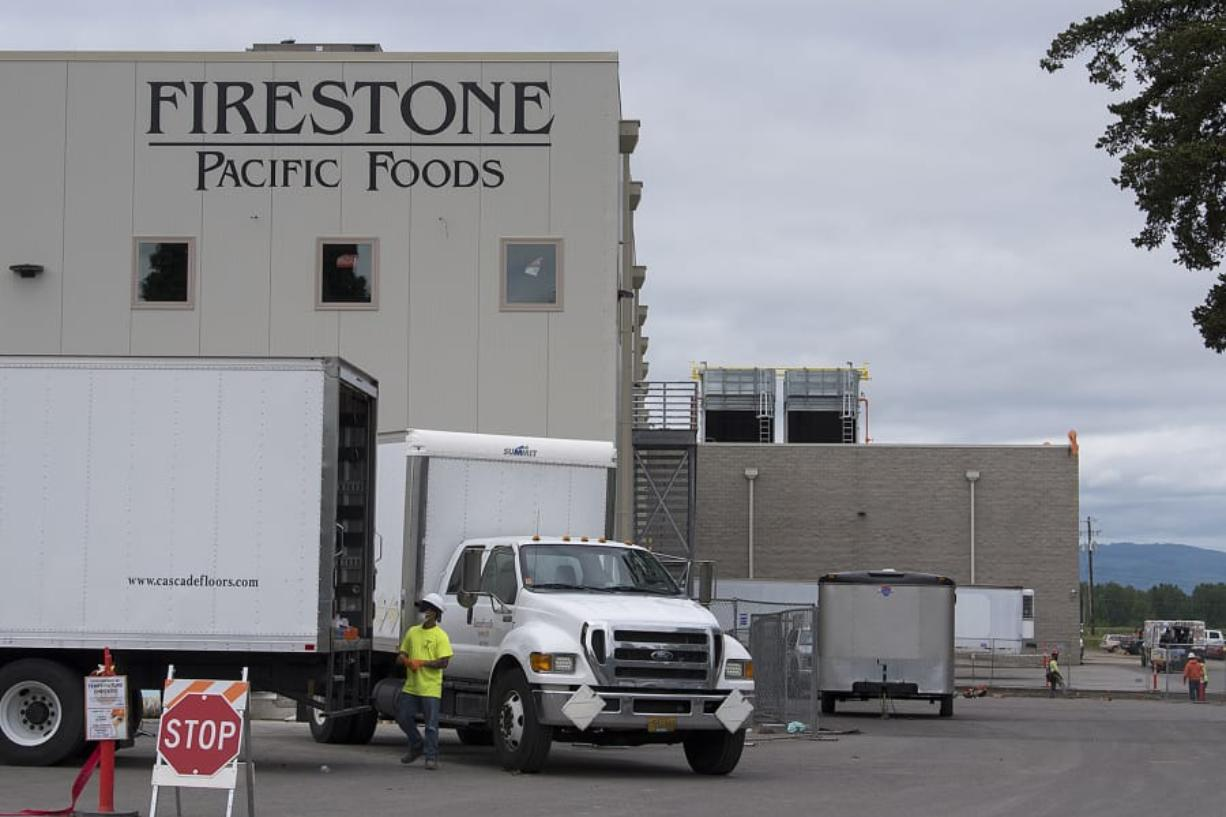 Work continues at Firestone Pacific Foods along Fruit Valley Road, after 69 employees of the plant tested positive for COVID-19. The facility has been allowed to continue some its production. There are 69 confirmed cases in facility employees and 15 confirmed cases in close contacts of those employees.