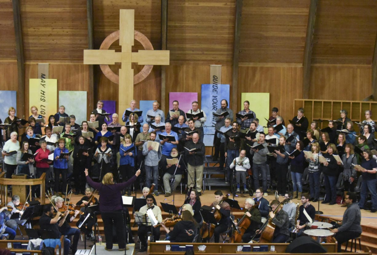 The Vancouver Master Chorale, plus full orchestra, squeezes together during a rehearsal at First Presbyterian Church in Vancouver. The physical closeness seen here is a good example of why choirs now see no choice but to wait out the end of the coronavirus pandemic.