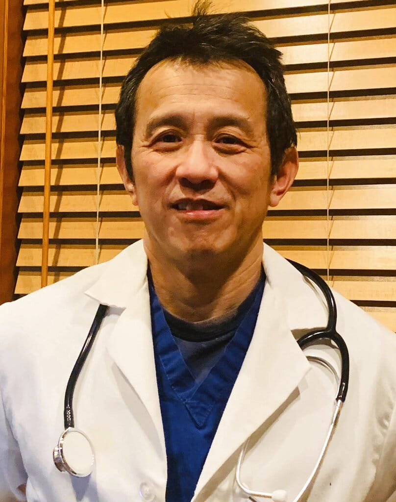 This photo taken March 27, 2020, and provided by Dr. Ming Lin, depicts him at his home in Bellingham, Washington. Lin, who was fired from his position as an emergency room physician at PeaceHealth St. Joseph Medical Center in Bellingham after he publicly complained about the hospital's COVID-19 preparations, sued for wrongful termination on Thursday, May 28, 2020.