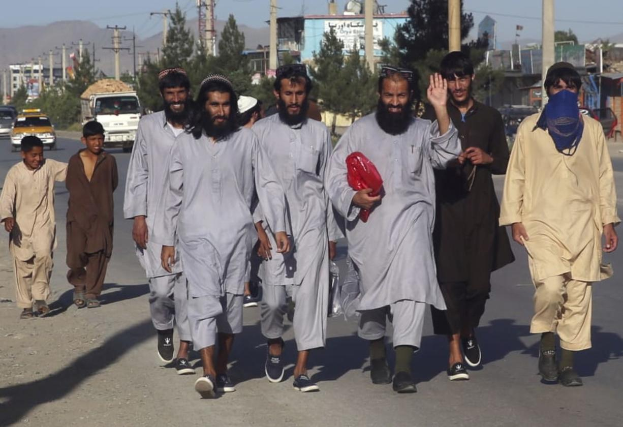 Afghan Taliban prisoners freed from Bagram Prison walk in Kabul, Afghanistan on Tuesday.