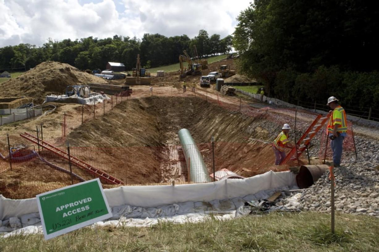 FILE - In this June 22, 2018, file photo, construction crews are boring beneath U.S. 221 in Roanoke County, Va., to make a tunnel through which the Mountain Valley Pipeline will pass under the highway. The U.S. Army Corps of Engineers has suspended a nationwide program used to approve oil and gas pipelines, power lines and other utility work, spurred by a court ruling that industry representatives warn could slow or halt numerous projects over environmental concerns.