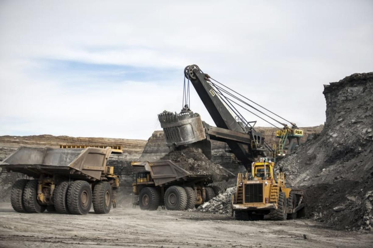 FILE - In this Jan. 9, 2014, file photo, a shovel loads haulers with coal at the Antelope Mine north of Douglas, Wyo. A coalition of U.S. states, environmentalists and an American Indian tribe are seeking to revive a moratorium on coal sales from public lands in the West.
