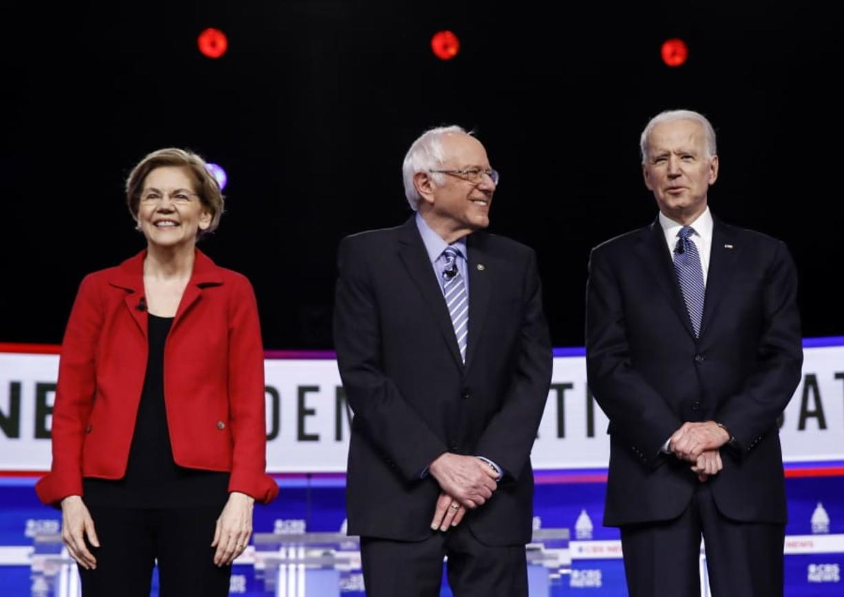 FILE - In this Feb. 25, 2020, file photo from left, Democratic presidential candidates, Sen. Elizabeth Warren, D-Mass., Sen. Bernie Sanders, I-Vt., former Vice President Joe Biden, and Sen. Amy Klobuchar, D-Minn., participate in a Democratic presidential primary debate in Charleston, S.C. Calls for pragmatic centrism helped Joe Biden clinch the Democratic presidential nomination. But they left many of the party's strongest liberals worried that little progress would be made toward their sweeping goals.