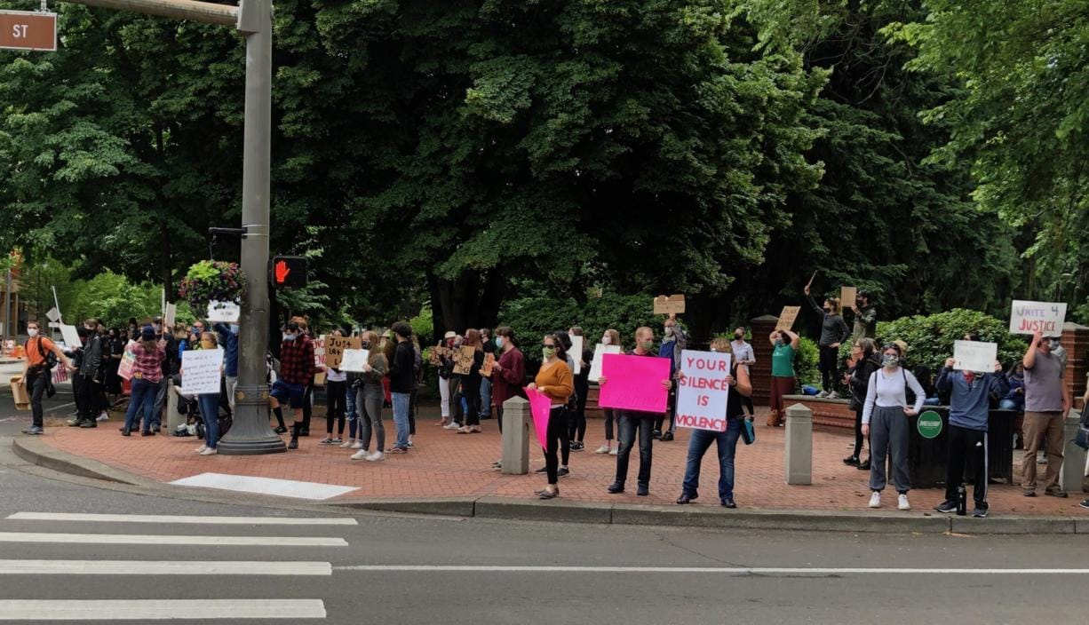 Demonstrators gathered at the corner of West 8th Street and Columbia on Sunday. It was part of protests in cities nationwide following the death of George Floyd in Minneapolis on May 25.