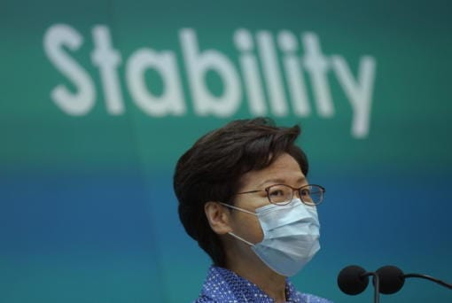 Hong Kong Chief Executive Carrie Lam listens to reporters' questions during a press conference in Hong Kong, Tuesday, May 26, 2020. Lam tried again Tuesday to defend a new national security law that China's parliament is going to impose on Hong Kong.