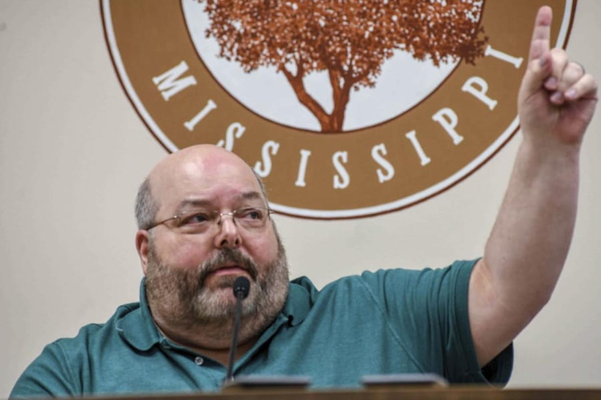 Petal Mayor Hal Marx raises his hand and refuses to resign at a special board of aldermen meeting at Petal City Hall, Thursday, May 28, 2020, in Petal, Miss., over comments he made about the death of Minneapolis man George Floyd at the hands of police, on social media.