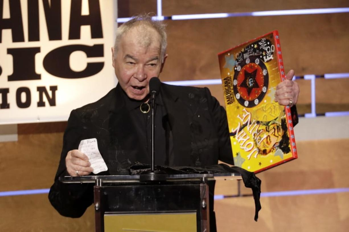 "FILE - This Sept. 11, 2019 file photo shows John Prine accepting the Album of the Year award at the Americana Honors & Awards show in Nashville, Tenn. The Recording Academy has released a new recording of John Prine's ""Angel From Montgomery"" with proceeds going to support the MusiCares COVID-19 Relief Fund. Prine died in April at age 73 from complications associated with the new coronavirus."