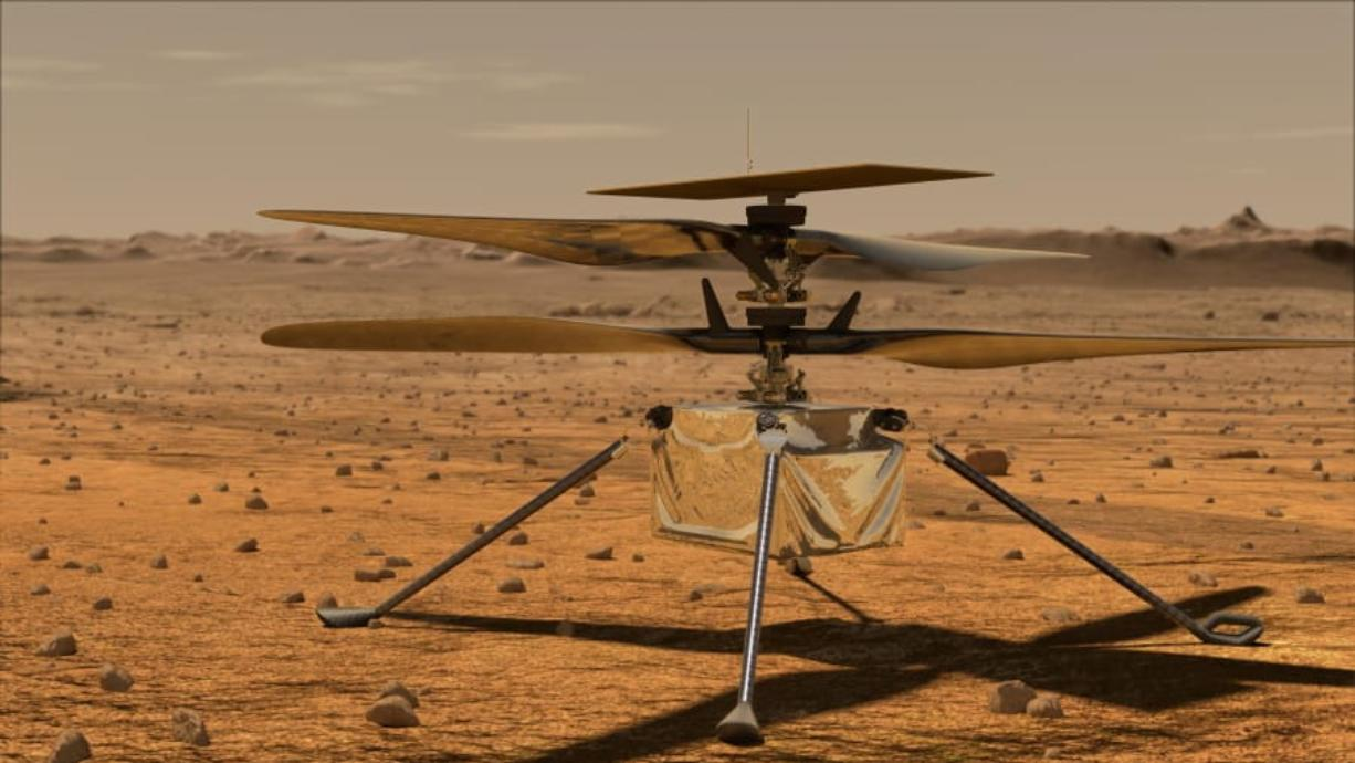 """In this artist rendering made available by NASA, depicts a helicopter that will be deployed in Mars later this summer. Vanessa Rupani, an Alabama high school student, won a contest to name the 4-pound solar-powered helicopter. Ingenuity, was the winning name that Rupani submitted from 28,000 names submitted in NASA's """"Name the Rover"""" essay contest for K-12 students in the U.S."""