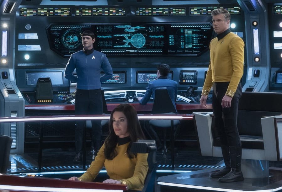 """Ethan Peck as Spock, from left, Rebecca Romijn as Number One, and Anson Mount as Captain Pike of the CBS All Access series """"Star Trek: Strange New Worlds."""" (Michael Gibson/CBS)"""