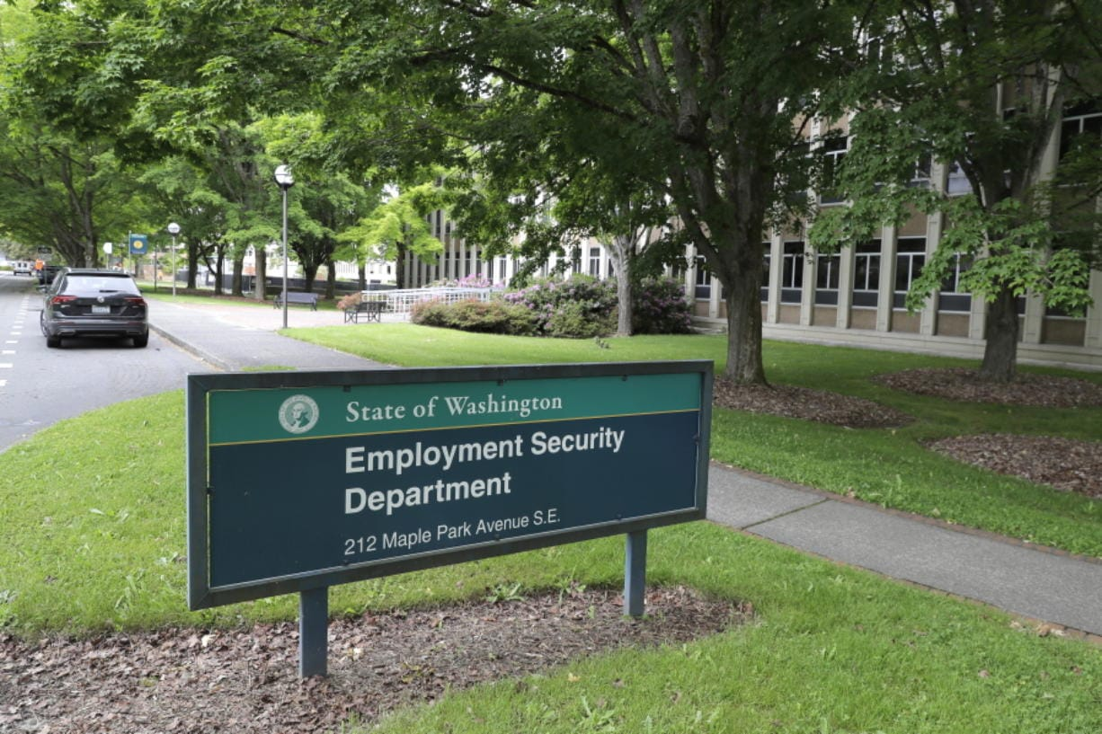 A sign at the headquarters for Washington state's Employment Security Department Tuesday, May 26, 2020, at the Capitol in Olympia. (AP Photo/Ted S.