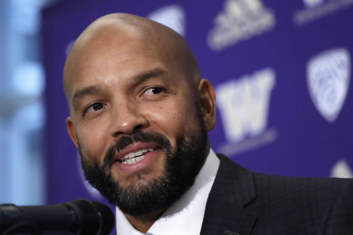 FILE - In this Dec. 3, 2019, file photo, Washington NCAA college football defensive coordinator Jimmy Lake speaks during a news conference about taking over the head coaching position, in Seattle. Just when it seemed like things were up and rolling, the COVID-19 pandemic hit. The ensuring national shutdown hurt coaches across college football as they prepare for next season, but it was particularly difficult on programs with first-year coaches trying to build something from the ground up.