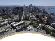 Downtown Seattle and mostly empty streets are shown, Wednesday, May 27, 2020, as viewed from the Space Needle. Many workers continue to work from home due to stay-at-home orders intended to prevent the further spread of the coronavirus. (AP Photo/Ted S.