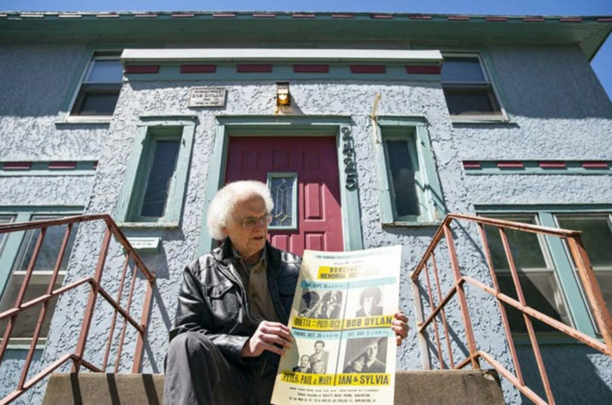 Bill Pagel on the steps of Bob Dylan's home in Hibbing, Minn., which he badgered the owners for years to sell to him. He admits he paid a premium because of its history.
