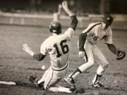 Prairie's Ryan Issacson fields a throw as Columbia River's Matt Grammer slides into second base during a game on April 1, 1989. Prairie, which won that game 2-0, would go on to claim the AA state championship that year.