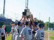 King's Way Christian baseball players hoist the championship trophy after beating Cedar Park Christian in 2017.