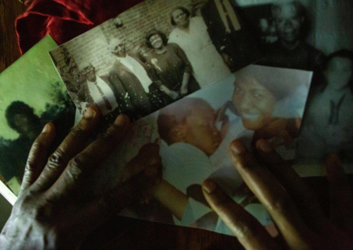 Angela Harrelson of Eagan, Minn., aunt of George Floyd, displays a photo of Floyd as a baby being held by his late mother, Larcenia Jones Floyd, on June 3, 2020.