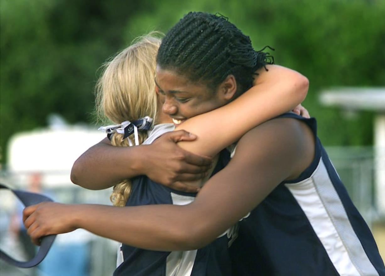 Skyview's Kara Lefebvre hugs winning pitcher Chemil Washington after the Storm beat W.F. West 3-2 in 8 innings for the 2001 3A state championship.
