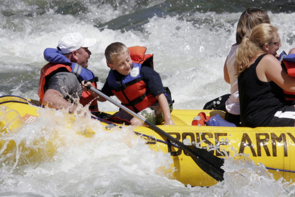 Tanner Myers of Lisbon, N.D., and Jon Hauf of Lisbon raft the Boise River in June 2008 on the opening day of the float season.