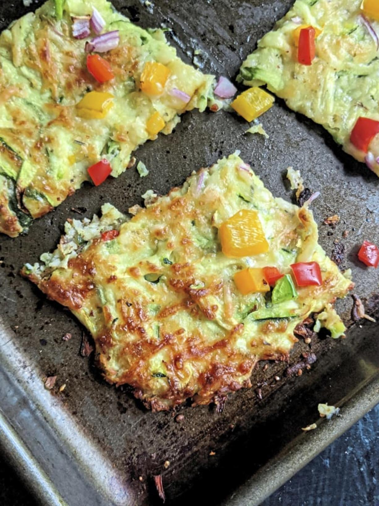 This vegetarian pizza is made with shredded zucchini, mozzarella and Parmesan cheeses and egg.