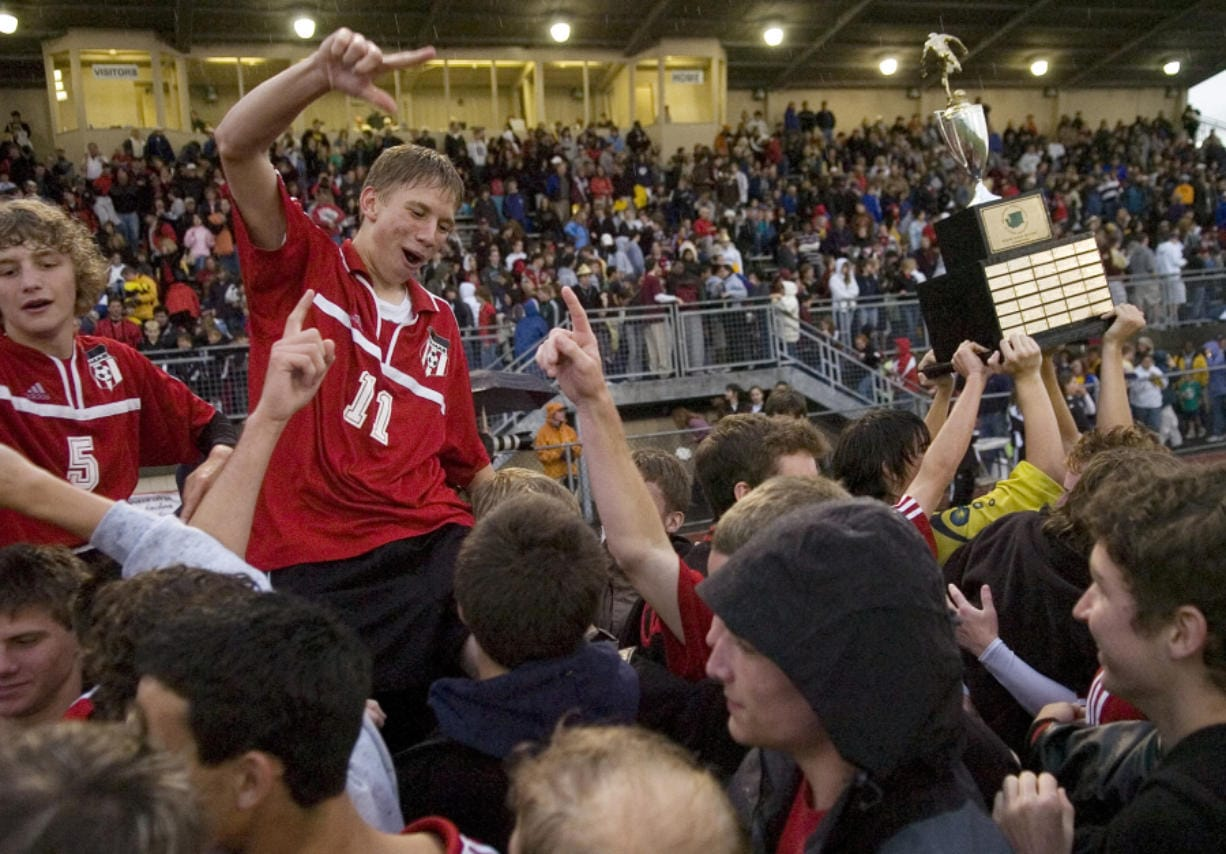 Camas players Billy Keyser, left, and Jason Martschinske, celebrate with fans after winning the 3A boys state soccer championship on May 27, 2006, at Sumner.
