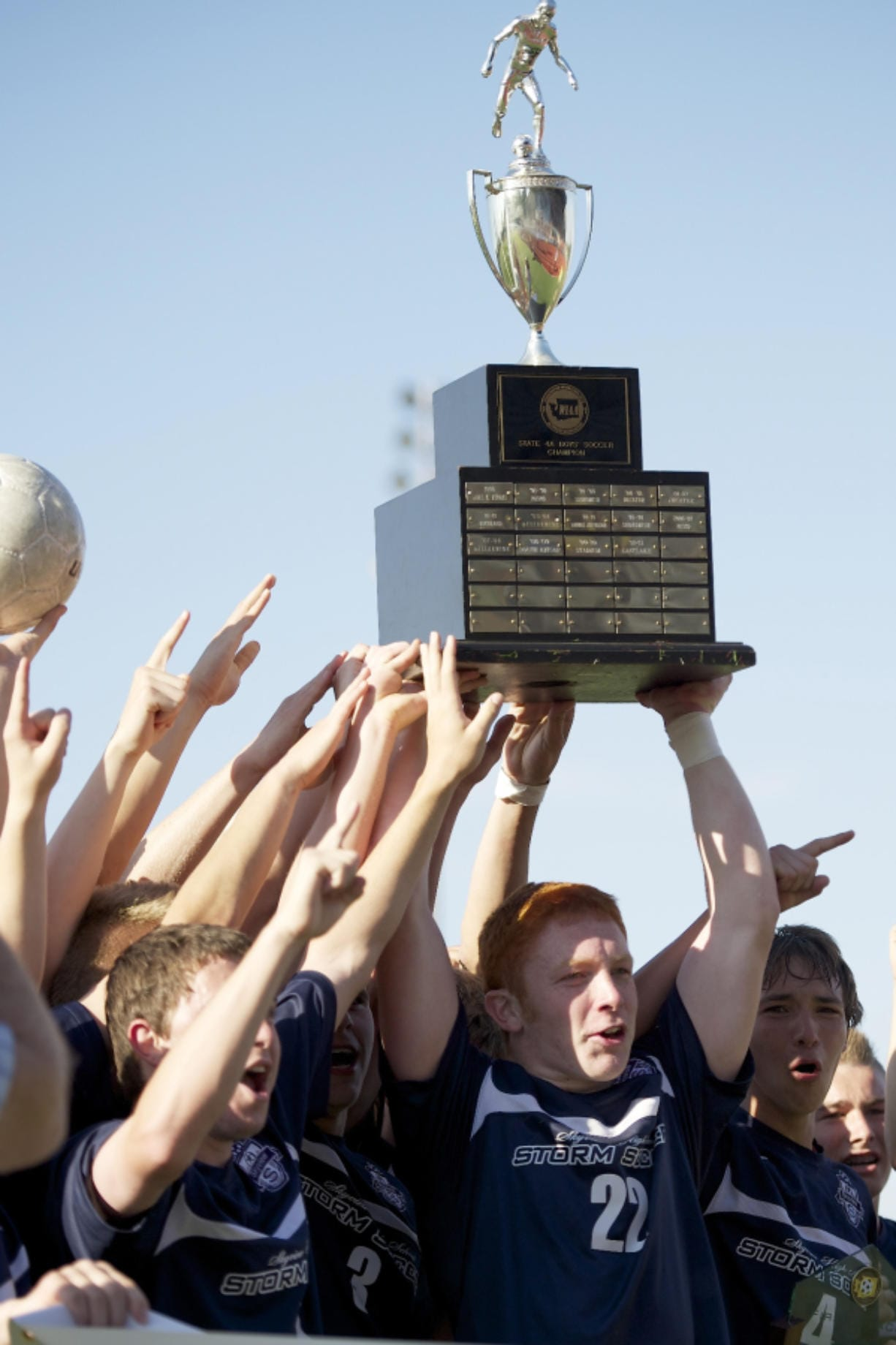 Skyview's Hayden Schuh, center, and teammates hoist the boys 4A state soccer championship trophy on May 26, 2012 at Puyallup. Skyview beat Central Kitsap 3-2.