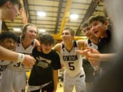 Spencer McGuire (third from left) tried out for the Union High School basketball team at the urging of Tanner Toolson (5) (Samuel Wilson for The Columbian)
