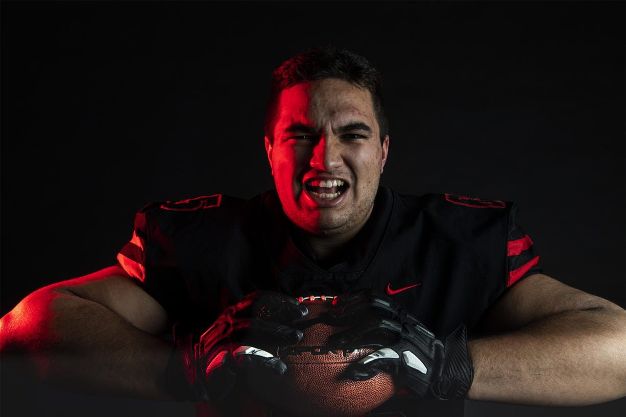 Camas senior Tai Tumanuvao poses for a press photo in The Columbian studio on Wednesday afternoon, Dec. 13, 2019.