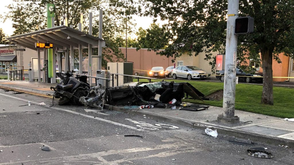 Vancouver police are investigating a Thursday night injury crash in which one of the involved cars was ripped in half when it struck a light pole.