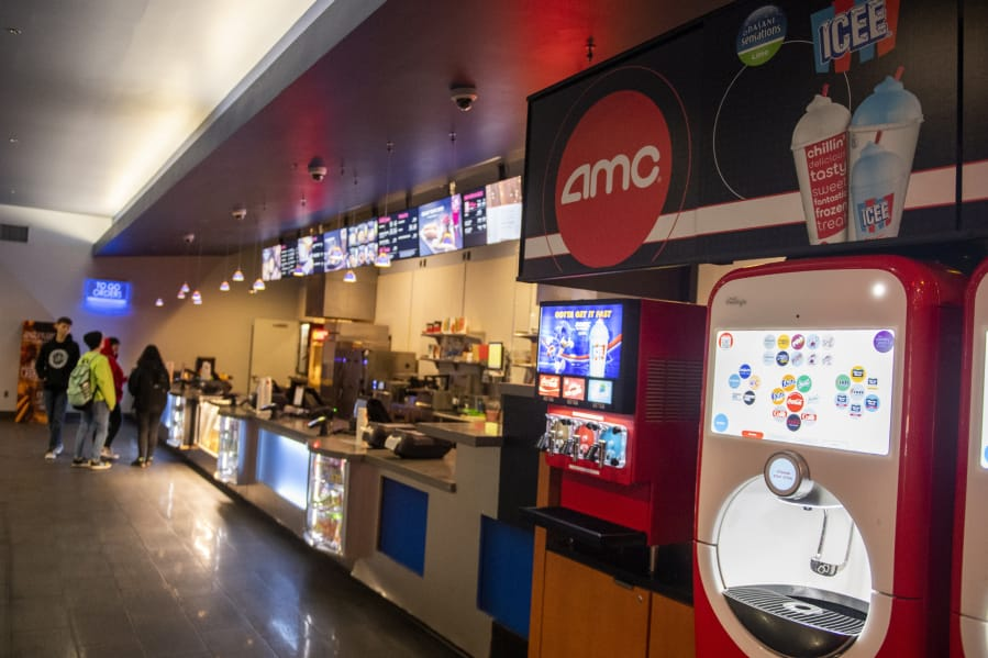 Customers pick up concessions at AMC Vancouver Mall 23. All theaters in Clark County have been shuttered for months due to COVID-19, but Clark County may soon move to Phase 3 of the state's reopening plan, which will allow for theaters to resume operations with seating capacity limits.