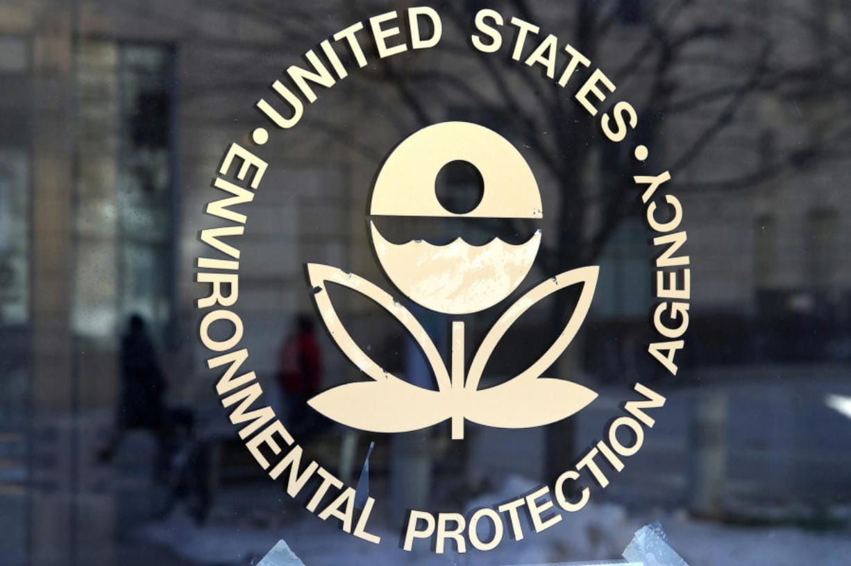 The U.S. Environmental Protection Agency's logo is displayed on a door at its headquarters in Washington, D.C. The temporary policy relaxing reporting requirements on pollutants, due to coronavirus, will end in August.