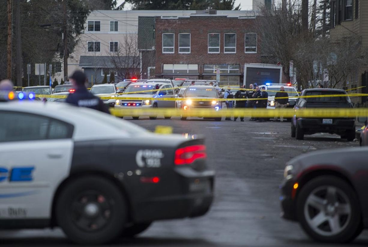 Crime scene tape and police cars are visible at the scene of a police shooting in downtown Vancouver in February 2019. State lawmakers are weighing in on renewed calls for police reform in Washington and across the country amid protests that have spread across the globe.