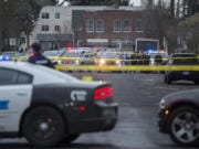 Crime scene tape and police cars are visible at the scene of a police shooting in downtown Vancouver in February 2019.