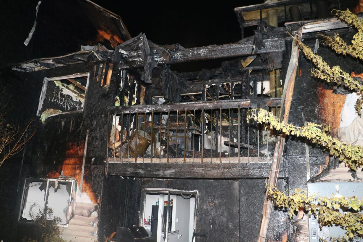 A two-alarm fire that heavily damaged a Sunpointe Apartments building, displacing more than 25 residents, was caused by improperly discarded smoking materials, according to the Vancouver Fire Marshal's Office.