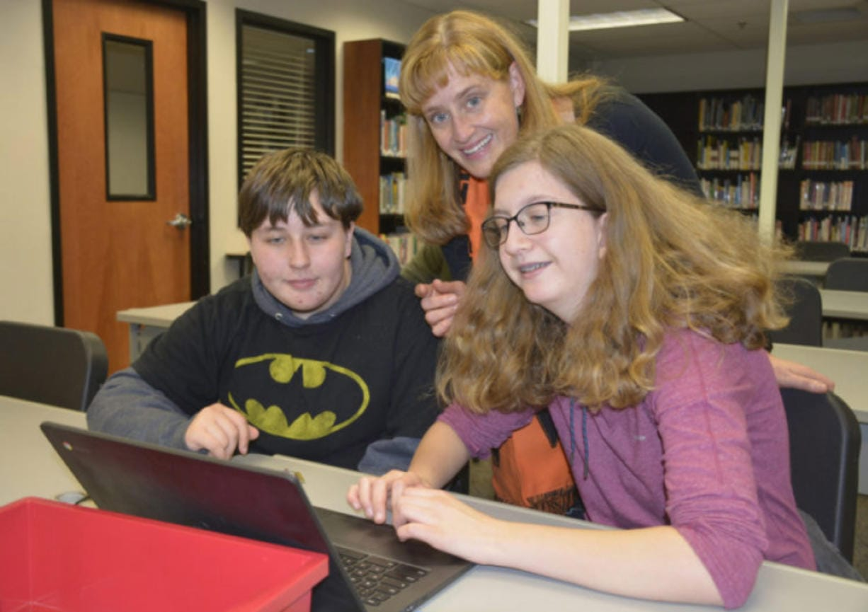 Hillary Marshall, middle, library media specialist at Washougal High School.