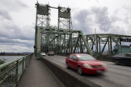 Motorists cross the Interstate 5 Bridge from Portland into Vancouver. Bridge traffic levels declined sharply during the first weeks of the coronavirus pandemic, but they've begun to recover -- and traffic officials say commuters should still plan for severe congestion in September when the northbound bridge span will close for maintenance for up to nine days.