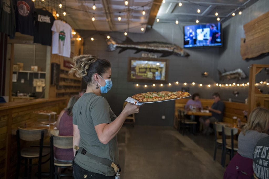 In Phase 2, restaurants in Clark County can open indoor dining but servers must wear masks.