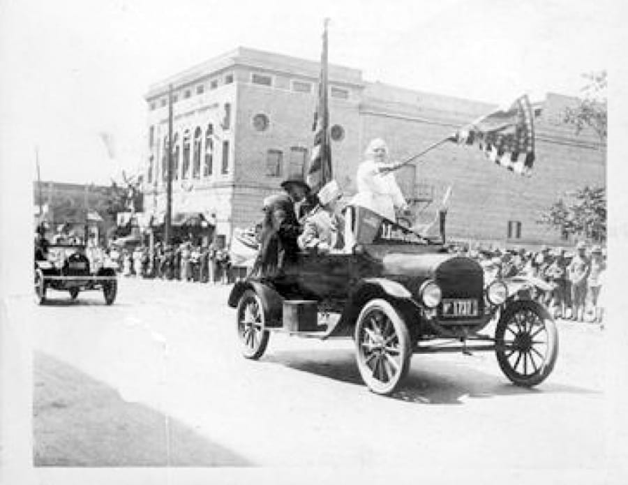 A Fourth of July 1917 parade float moves past Ninth and Main streets in downtown Vancouver.