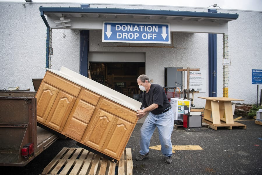 Tony Conner of Vancouver unloads a bathroom vanity to donate at the Clark County Habitat for Humanity Store on June 13. The store began accepting donations again earlier this month after closing during the statewide stay-home order.