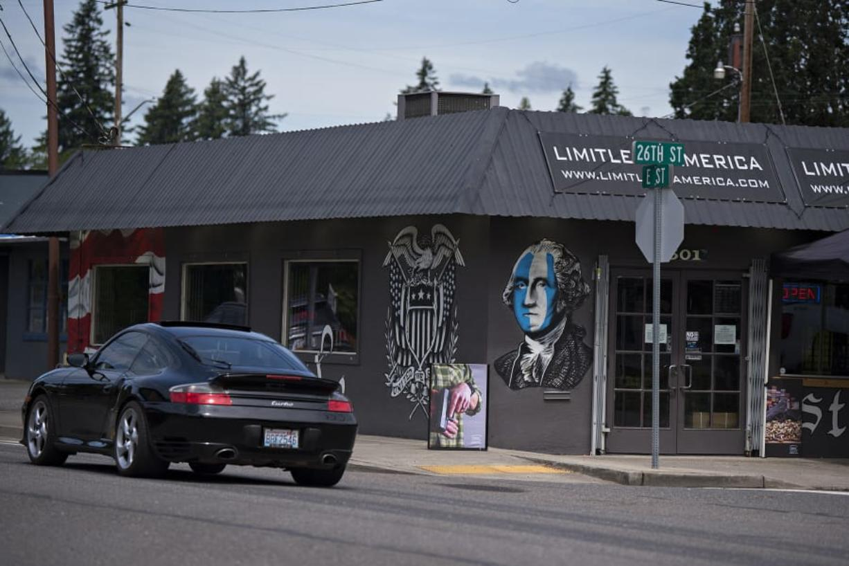 A motorist drives past Limitless America, a firearm retailer in Washougal, on Thursday morning. Photos circulating on social media of an armed group outside of Limitless America during a rally for black lives Sunday drew a number of concerns from community members.