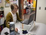 Speech-language pathologist Hillary Betzen waits to connect with a student for a session.