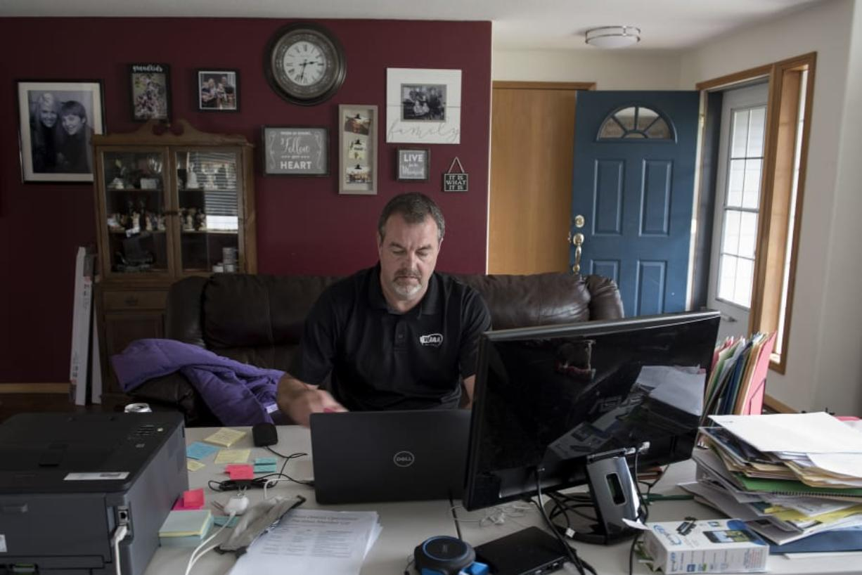 Mick Hoffman, the executive director of the Washington Interscholastic Activities Association, works from home on Monday afternoon, June 15, 2020.