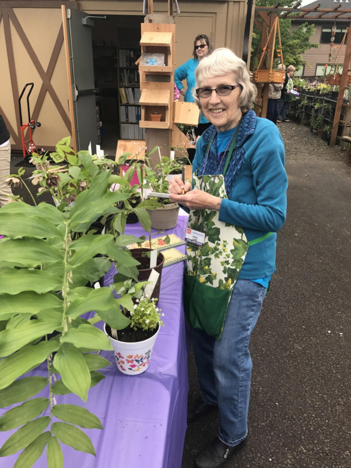 """Plant Fair organizer and Two Rivers Heritage Museum """"plant lady"""" Alma Ladd at a previous plant fair."""