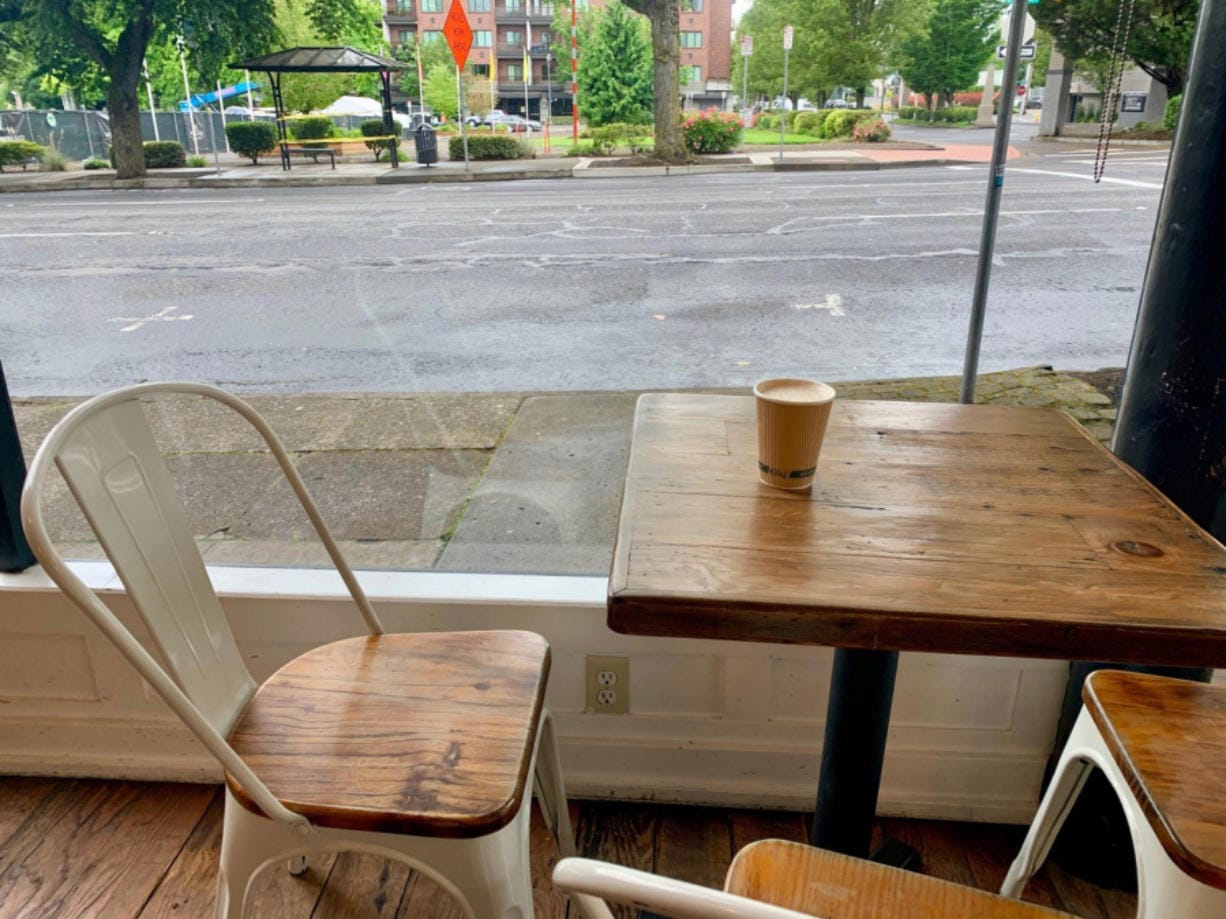 A table tucked in the corner at Compass Coffee is a cozy place to enjoy a chai.