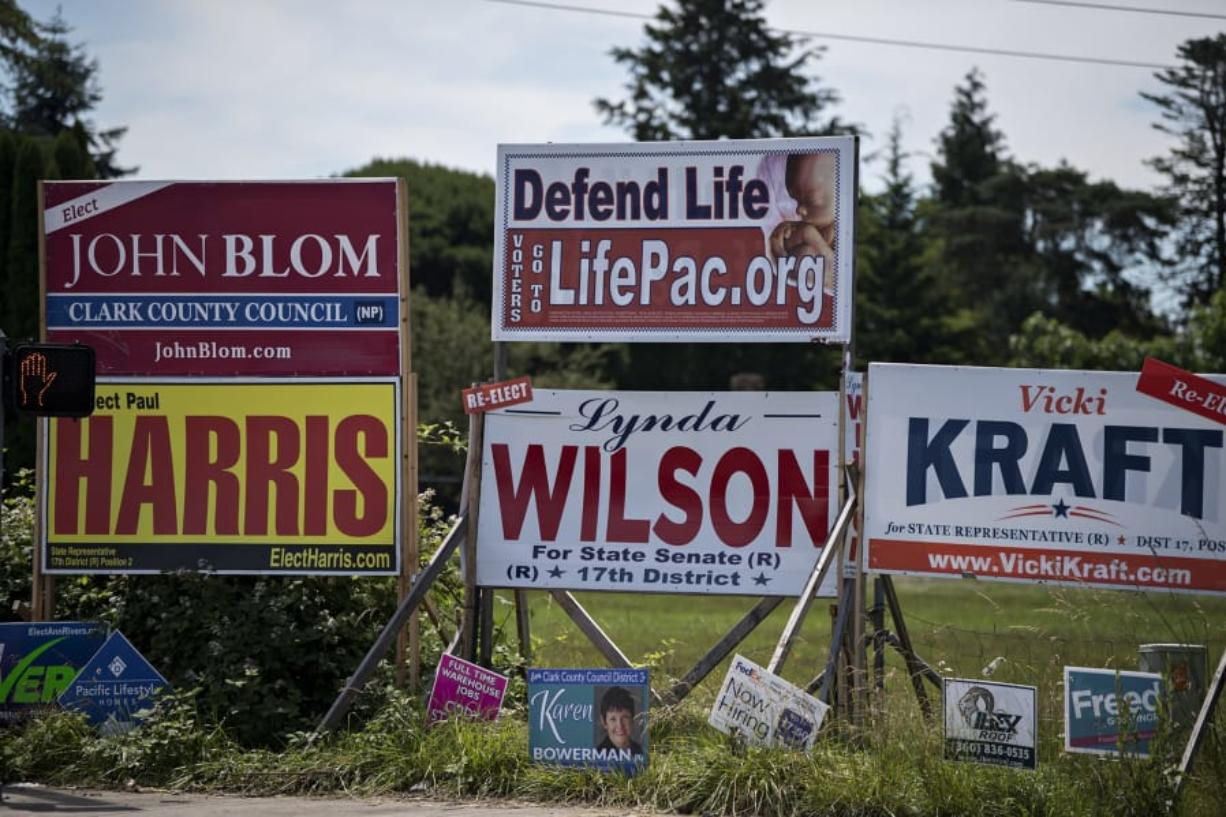 Signs for Clark County Council candidates John Blom and Karen Bowerman are pictured among others Tuesday in east Vancouver.